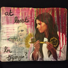 A collaborative art journal page with Beatriz Helton, a mixed media collage of a woman holding a key; the page was created with collage material, ink, and acrylic paint.